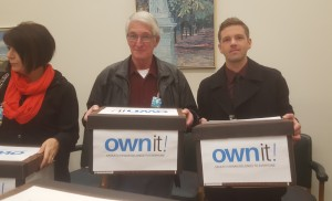 CUPE Saskatchewan President Tom Graham and Executive Assistant Andrew Loewen deliver Own It! petitions to the Legislature.